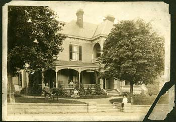 Photograph of Thomas Wolfe and his family in front of the family home in Asheville, N.C., ca. 1913. From the Digital North Carolina Collection Photographic Archives, UNC-Chapel Hill.