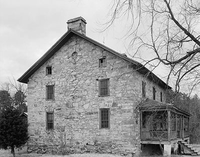 A black and white photo of the Hezekiah Alexander house, taken in 1936. Now included on the National Register of Historic Places, this unique house was made out of piedmont stones and oyster mortar. It now is part of the Charlotte History Museum grounds. Image courtesy of Library of Congress.