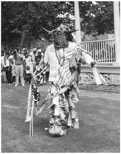 A performer reenacts the Jonkonnu ceremony at Somerset Plantation. The Jokonnu ceremony has roots in Jamaica and possibly Africa. A Christmas morning event, enslaved people would don costumes made of rags or animal skins. There would be dancing and often music or singing, and it was expected that participants would be rewarded with money or gifts by masters or other white people. Image courtesy of North Carolina Office of Archives & History, in association with the University of North Carolina Press.