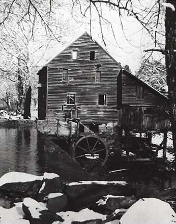 Photograph of Wake County's Yates Mill, ca. 1942. The mill was originally constructed in the 1750s and remained in use until the 1940s. Gristmills were often the center of rural community life. From the collections of the NC Museum of History.