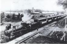Photograph of a cargo train loading furniture at the White Furniture Company in Mebane, N.C. , 1906. The train was headed for the Panama Canal. From the collection of the Alamance County Public Library, available at DigitalNC.