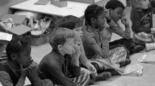 This is a 1973 photo of a mixed race, first grade classroom in North Carolina.