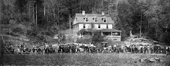 """First invasion of the automobile in the Grandfather Mountain region,"" 1908. Line of cars in front of the Inn at Edgemont, Caldwell County. Image from the North Carolina Museum of History."