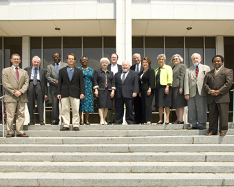 The North Carolina Historical Commission, 2009. From left to right: Dr. Richard D. Starnes, Prof. William S. Powell (emeritus), Dr. David C. Dennard, Dr. Harry L. Watson, Dr. Valerie A. Johnson, Dr. Mary Lynn Bryan, Mr. B. Perry Morrison Jr., Dr. Jerry C. Cashion (Chair), Dr. Jeffrey J. Crow (Secretary), Secretary Linda A. Carlisle, Department of Cultural Resources, Mrs. Millie Barbee (Vice-Chair), Mrs. Barbara Blythe Snowden, Dr. H. G. Jones (emeritus), Dr. Freddie L. Parker. Image from the North Carolina Office of Archives and History.