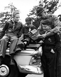 Unidentified NC Highway Patrol personnel, c.1960, with Boy Scouts and Cub Scout. From NC Department of Conservation and Development, Travel and Tourism photo files, North Carolina State Archives, Raleigh, NC, call #:  ConDev_TID_367_2.