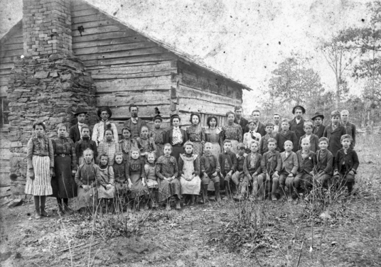 Students and teacher in front of their log school, Davidson County, late nineteenth century. North Carolina Collection, University of North Carolina at Chapel Hill Library.