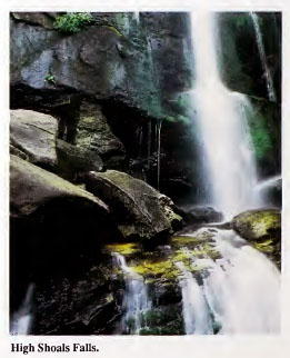 Image of exposed granite face of High Shoals Falls (Burke County, N.C.).  From the <i>Geologic Guide to North Carolina's State Parks</i>, published 1989 by the North Carolina Geological Survey.  Presented on NC Digital Collections.