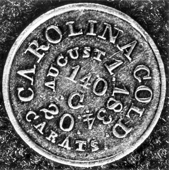 Enlargement of the obverse of a five-dollar gold coin believed to have been struck between 1834 and 1837 by Christopher Bechtler Sr. The actual diameter of the coin is 24.7 mm. North Carolina Collection, University of North Carolina at Chapel Hill Library.
