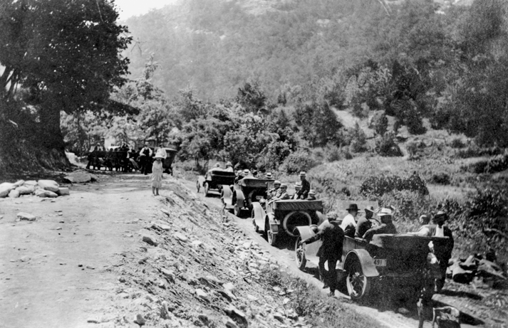 Automobiles, thought to be part of a caravan organized to illustrate the need for better roads, pause at Hickory Nut Gap near Asheville, 1916. North Carolina Collection, University of North Carolina at Chapel Hill Library.